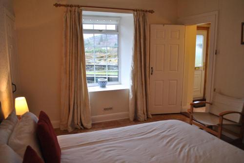 Ein Bett oder Betten in einem Zimmer der Unterkunft Salen Cottage