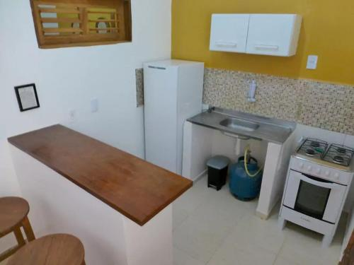 A kitchen or kitchenette at Vila Areia