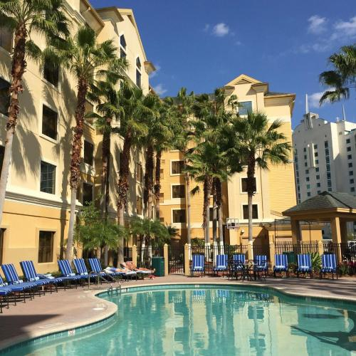 The swimming pool at or near staySky Suites I-Drive Orlando Near Universal