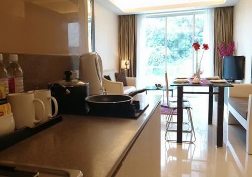 A kitchen or kitchenette at Damas Suites & Residences Kuala Lumpur