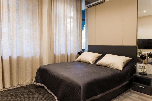 Кровать или кровати в номере Апартаменты Малон