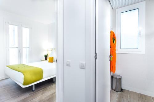 Krevet ili kreveti u jedinici u okviru objekta Cosmo Apartments Marina – Auditori
