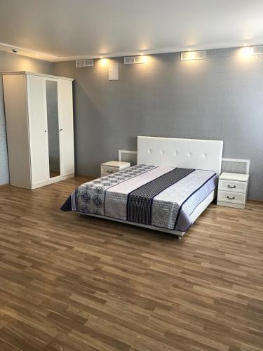 Кровать или кровати в номере Гостиный двор