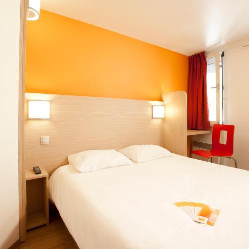 Un ou plusieurs lits dans un hébergement de l'établissement Premiere Classe Toulouse Sesquières