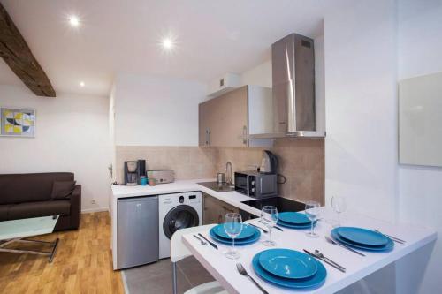 Küche/Küchenzeile in der Unterkunft CMG Marais _Blancs Manteaux