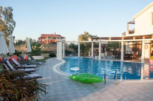 Πισίνα στο ή κοντά στο Villa Tasos