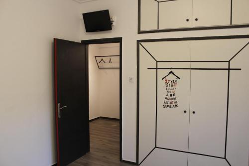 Телевизор и/или развлекательный центр в Xsoma Flats Kifisia