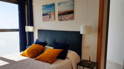 A bed or beds in a room at Benidorm Sky