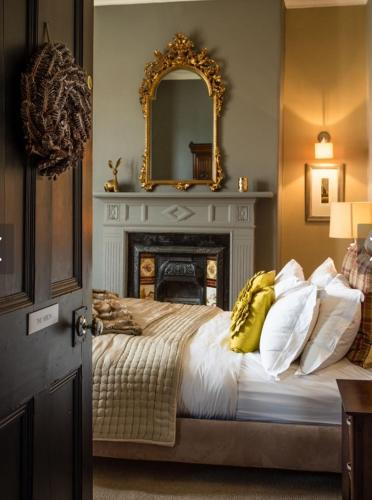 A bed or beds in a room at No.20 Boutique B&B
