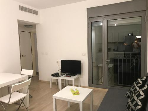 A television and/or entertainment center at BBA - Brand New 1BR in RavKook7