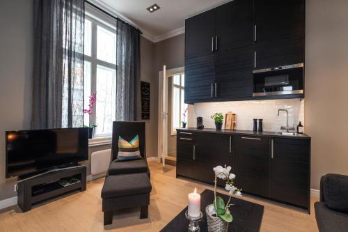 A kitchen or kitchenette at Josefinesgate Apartments