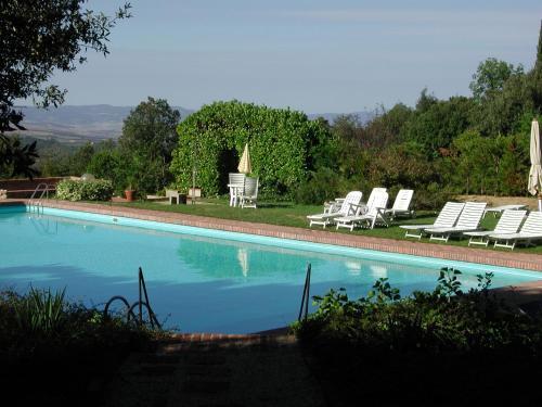 The swimming pool at or near Armonie del Chianti