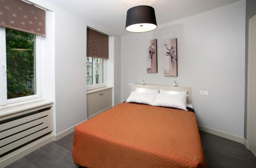A bed or beds in a room at Appartement Censier Daubenton