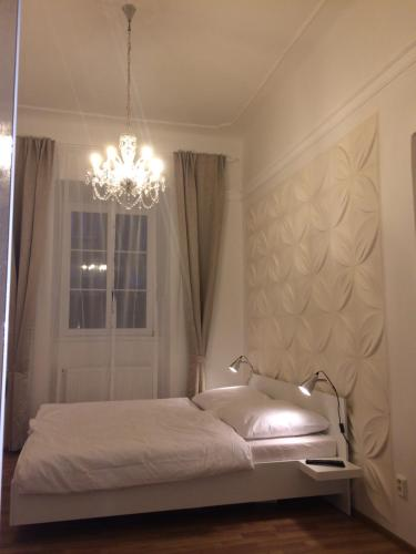 A bed or beds in a room at Prague Crystalette Apartment