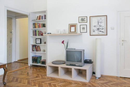 A television and/or entertainment center at Cozy Central Apartment