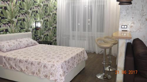 A bed or beds in a room at Транспортная 8