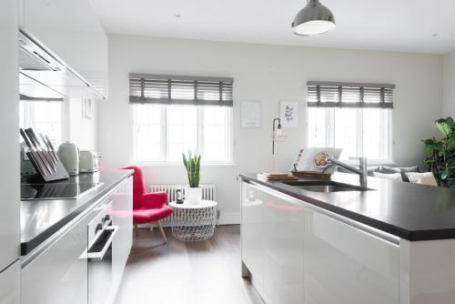A kitchen or kitchenette at The Soho Studio - Modern & Central 2BDR