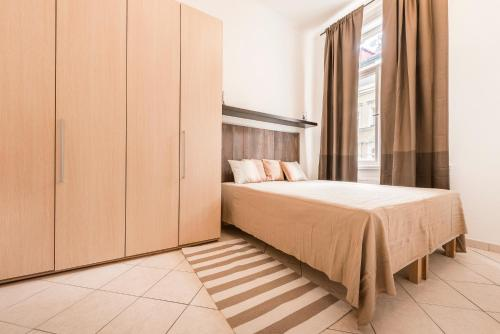 A bed or beds in a room at Tyrsova Apartment