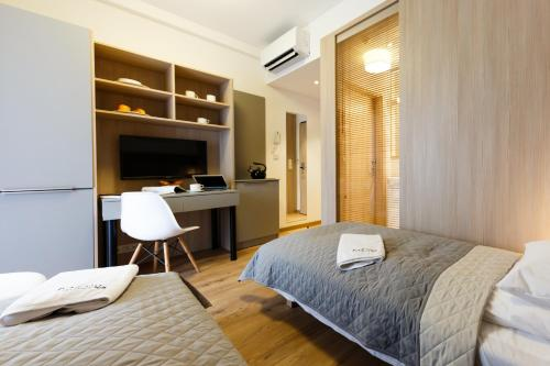 A bed or beds in a room at Micro Apartments Kazou Residence