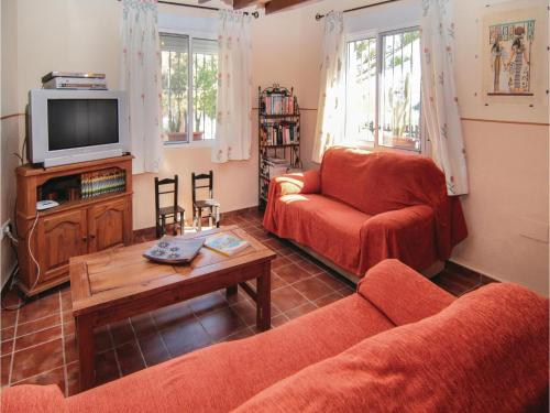 A seating area at Three-Bedroom Holiday Home in Torrox