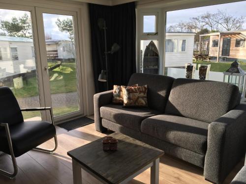 A seating area at Chalet Zeester J38 Ameland