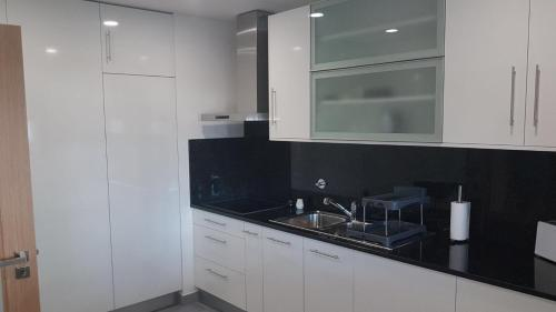 A kitchen or kitchenette at Sultanato Apartments Funchal