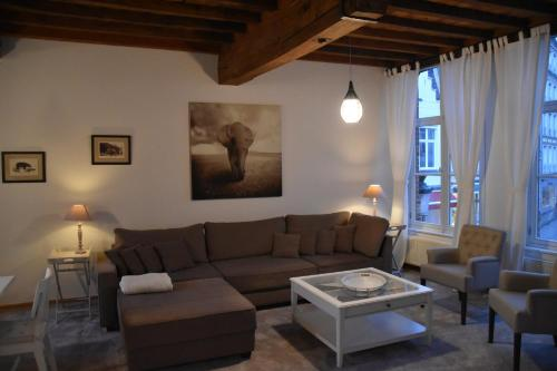 A seating area at Spacious Duplex App. Centre Bruges