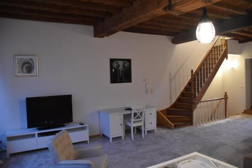 A television and/or entertainment center at Spacious Duplex App. Centre Bruges
