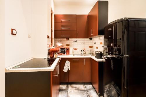 A kitchen or kitchenette at BpR Jazzy Art Home