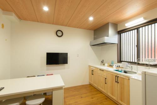 ゲストハウス 金ととにあるキッチンまたは簡易キッチン