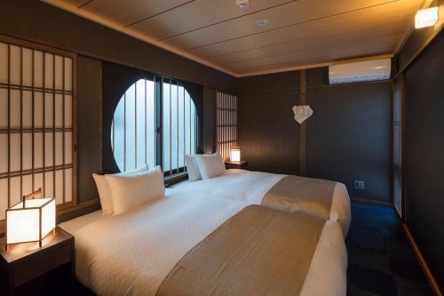 Ein Bett oder Betten in einem Zimmer der Unterkunft Fujinoma Machiya House