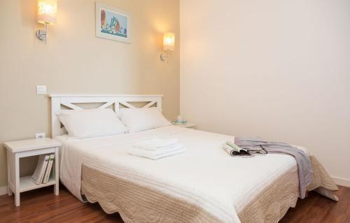 Ein Bett oder Betten in einem Zimmer der Unterkunft Résidence Prestige Odalys Fleur de Sel