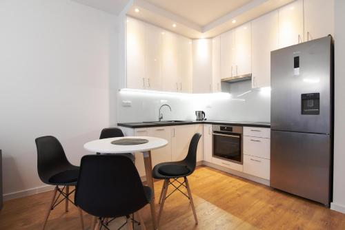 A kitchen or kitchenette at NotaBene Apartment