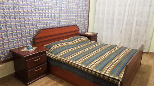 A bed or beds in a room at Machanents apartment