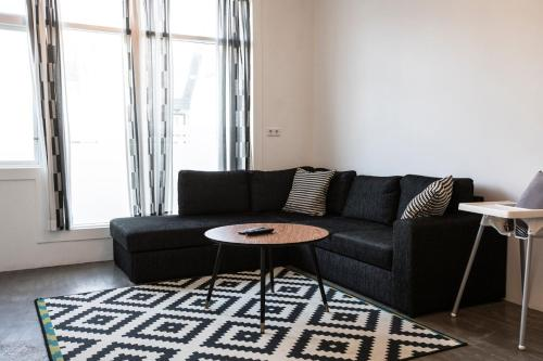 A seating area at G-Unit Apartment