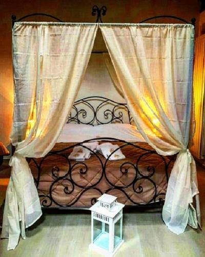 Postel nebo postele na pokoji v ubytování B&B La Lanterna