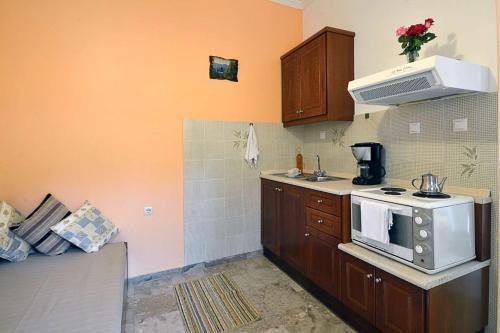 A kitchen or kitchenette at Maistro Apartments