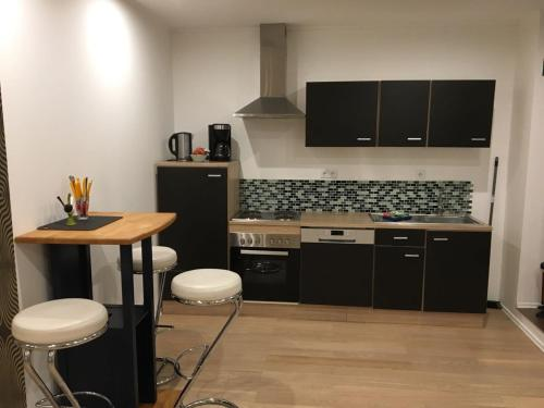 A kitchen or kitchenette at modern,light,clean 1Room Apartment central