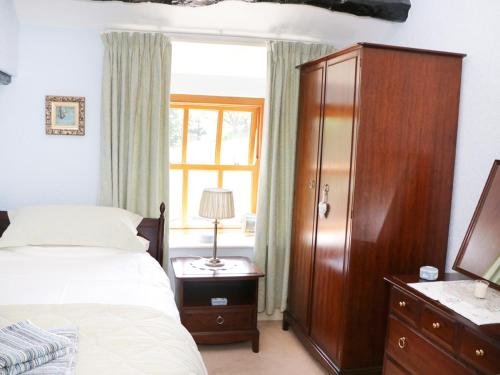 A bed or beds in a room at Undercragg