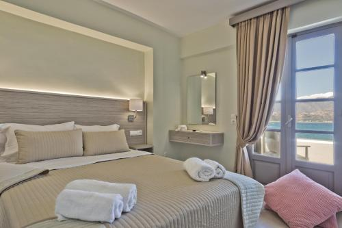 A bed or beds in a room at Nereus Luxurious Suites