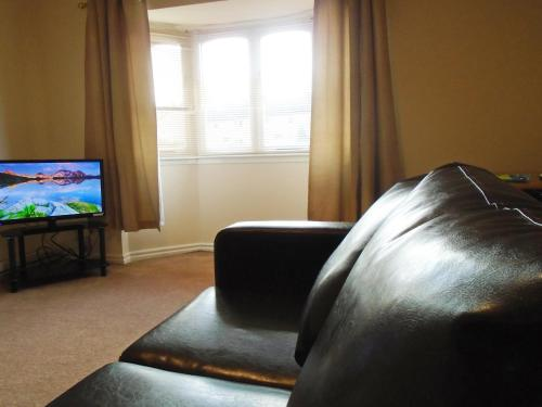 A television and/or entertainment center at Clydebank Apartment