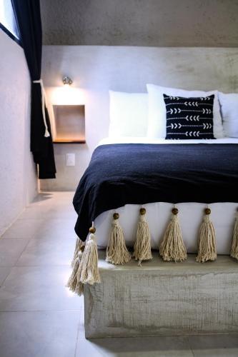 Cama o camas de una habitación en Aruma Hotel & Boutique