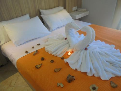 A bed or beds in a room at Ourania Studios