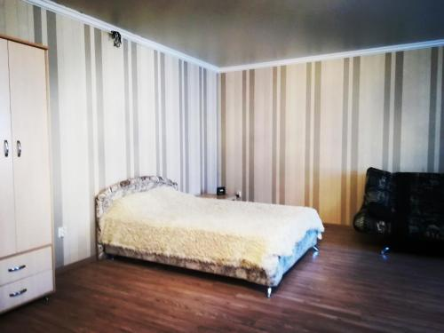 Кровать или кровати в номере студия