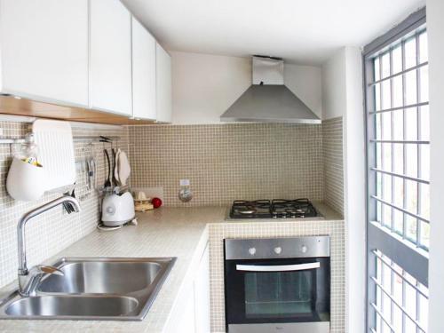A kitchen or kitchenette at Locazione turistica Dolce Vita Luxury Terrace