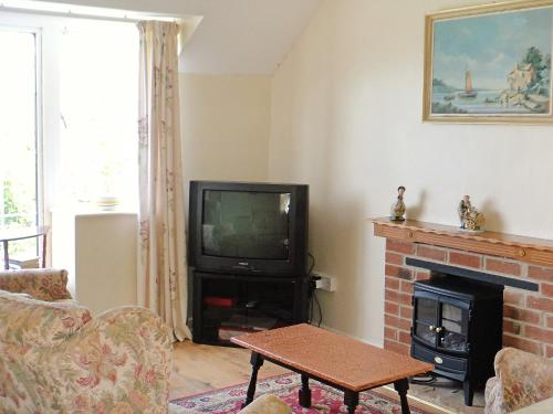 A television and/or entertainment center at Holiday Home Woodbury