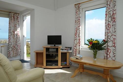 Et tv og/eller underholdning på White Wave Cottage