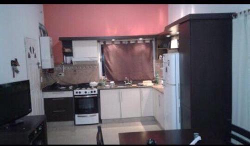 A kitchen or kitchenette at Casa Con Piscina Y Vista Al Lago
