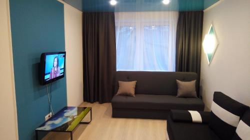 Телевизор и/или развлекательный центр в Pillau Apartments