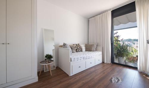 A bed or beds in a room at Dúplex con vistas panoramicas